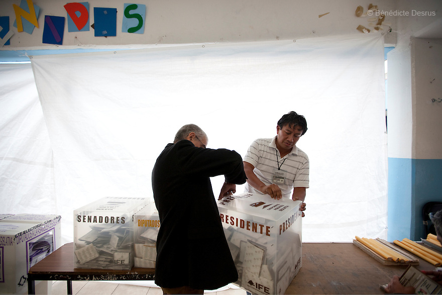 1 July 2012 - Mexico City, Mexico - Election workers open a ballot box to start counting votes during the Mexico general election at a polling station in Mexico City. Mexicans vote for a new president on july 1. Photo credit: Benedicte Desrus