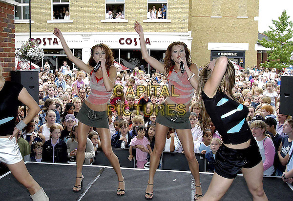 THE CHEEKY GIRLS.Open new HMV Music Store in Staines Retail park.www.capitalpictures.com.sales@capitalpictures.com.©Capital Pictures.twins, sisters, fans, belted micro mini skirt, singing,dancing