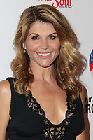 ***FILE PHOTO*** Lori Loughlin and husband, Mossimo Giannulli, will plead guilty to conspiracy charges in connection with securing  fraudulent admission of their two daughters.<br /> <br /> BEVERLY HILLS, CA - SEPTEMBER 27: Lori Loughlin at the Hero Dog Awards at the Beverly Hilton in Beverly Hills, CA on September 27, 2014. <br /> CAP/MPI/DE<br /> ©DE//MPI/Capital Pictures