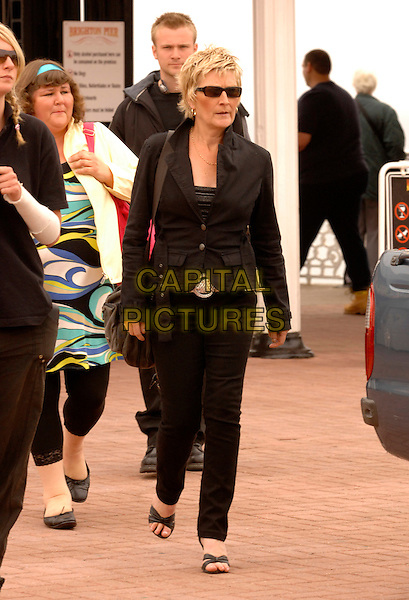 LINDA HENRY.Actress who plays Shirley in Eastenders, leaves Brighton Pier after filming Eastenders, Palace Pier, Brighton, .East Sussex, England, June 11th 2007..full length black jeans coat jacket sunglasses.CAP/IL.©Ian Leonard/Capital Pictures.