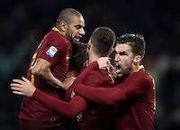 Calcio, Serie A: Roma vs Cagliari, Roma, stadio Olimpico, 22 gennaio 2017.<br /> Roma's Edin Dzeko, center, celebrates with teammates Daniele De Rossi, left, Bruno Peres, second from left, and Kevin Strootman, right, after scoring during the Italian Serie A football match between Roma and Cagliari at Rome's Olympic stadium, 22 January 2017. <br /> UPDATE IMAGES PRESS/Isabella Bonotto