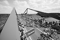peloton riding over the Meuse river <br /> <br /> Eneco Tour 2013<br /> stage 6: Riemst - Aywaille (La Redoute) <br /> 150km
