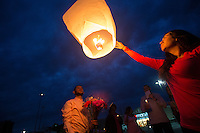 BURLINGTON, WA - SEPTEMBER 26: Soledad Lara (right) lets go of a light lantern during a candlelight vigil in a parking lot of the Cascade Mall on September 26, 2016 in Burlington, Washington. Five people were killed in the Macy's department store behind them by a gunman several night's ago. Among the dead was Lara's sister, Sarai. The suspect, Arcan Cetin, 20, a resident of Oak Harbor, Washington, was arraigned today. (Photo by Karen Ducey/Getty Images)