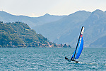 Sailing on Lake Como, Italy with the town of Varenna in the background