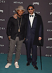 LOS ANGELES, CA - NOVEMBER 07: Recording artist Usher (L) and RETNA attend LACMA 2015 Art+Film Gala Honoring James Turrell and Alejandro G Iñárritu, Presented by Gucci at LACMA on November 7, 2015 in Los Angeles, California.