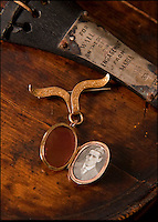 BNPS.co.uk (01202 558833)<br /> Pic: Phil Yeomans/BNPS<br /> <br /> And the band played on...<br /> <br /> Poignant reminder - Maria Robinson's locket with a picture of Wallace inside.<br /> <br /> The violin played by the bandmaster on the Titanic as the ship was sinking is finally being auctioned for an estimated &pound;400,000.<br /> <br /> The wooden instrument has been proven to be the one used by Wallace Hartley as his band famously played on to help keep the passengers calm during the disaster.<br /> <br /> Its existence and survival only emerged in 2006 when the son of an amateur violinist who was gifted it by her music teacher in the early 1940s contacted an auctioneers.
