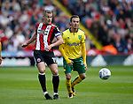 Paul Coutts of Sheffield Utd tussles with James Maddison of Norwich City during the Championship match at Bramall Lane Stadium, Sheffield. Picture date 16th September 2017. Picture credit should read: Simon Bellis/Sportimage