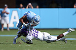 17 September 2016: UNC's Mack Hollins (13) is tackled by JMU's Rashad Robinson (22). The University of North Carolina Tar Heels hosted the James Madison University Dukes at Kenan Memorial Stadium in Chapel Hill, North Carolina in a 2016 NCAA Division I College Football game.