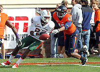 Oct 30, 2010; Charlottesville, VA, USA; Miami Hurricanes wide receiver Leonard Hankerson (85) drops the pass in front of Virginia Cavaliers cornerback Mike Parker (43) during the 1st half of the game at Scott Stadium.  Mandatory Credit: Andrew Shurtleff