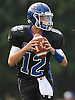 Kyle Tiernan #12, Glenn quarterback, looks for an open receiver during the second quarter of a Suffolk County Division IV varsity football game against Mount Sinai at Glenn High School on Saturday, Sept. 10, 2016.