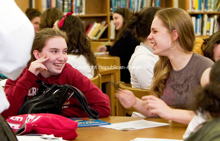 LITCHFIELD, CT- 04 APRIL 07- 040407JT05- <br /> Wamogo High School seniors Brigitte Phelan, 17, of Morris, and Michelle Perna, 18, of Litchfield, share a laugh as they wait for their turns to audition for MTV's &quot;Made&quot; at the school's library in Litchfield on Wednesday. <br /> Josalee Thrift Republican-American