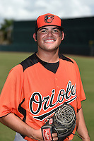 Baltimore Orioles pitcher Brian Gonzalez (59) poses for a photo after an Instructional League game against the Tampa Bay Rays on September 15, 2014 at Ed Smith Stadium in Sarasota, Florida.  (Mike Janes/Four Seam Images)