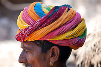 Indian man wearing traditional Rajasthani turban and gold earring in village of Nimaj, Rajasthan, Northern India