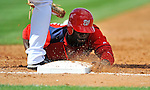 28 February 2011: Washington Nationals' outfielder Roger Bernadina dives safely back to first during a Spring Training game against the New York Mets at Digital Domain Park in Port St. Lucie, Florida. The Nationals defeated the Mets 9-3 in Grapefruit League action. Mandatory Credit: Ed Wolfstein Photo