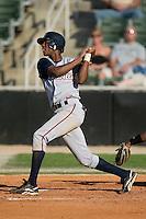 Asheville shortstop Hector Gomez (3) follows through on his swing versus Kannapolis at Fieldcrest Cannon Stadium in Kannapolis, NC, Sunday, April 29, 2007.
