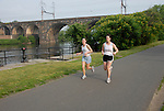Boathouse Row area along the Schuylkill River, joggers, mod rel..Philadelphia, Pennsylvania, PA USA.  Photo copyright Lee Foster, 510-549-2202, lee@fostertravel.com, www.fostertravel.com. Photo 313-30190