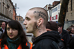 "© Joel Goodman - 07973 332324 - all rights reserved . 20/03/2010 . Bolton , UK . A man with a tattoo that reads "" Manchester Punx "" on his head . The English Defence League ( EDL ) hold a demonstration in Bolton , opposed by Unite Against Fascism ( UAF ) . Photo credit : Joel Goodman"