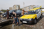 Kabul, Afghanistan; October 21, 2002 -- Men, boys washing cars; people, infrastructure -- Photo: © HorstWagner.eu