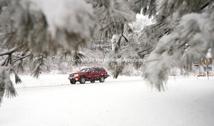 NORFOLK,  CT-122916JS09--While most of the state received only rain from Thursday's storm, part Norfolk saw heavy snowfall and accumulation. Drivers traveling along Route 44 in Norfolk drove slow and cautiously. <br /> Jim Shannon Republican-American