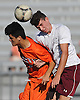 Luke Connolly #13 of Garden City, right,  heads a ball away from William Rivera #9 of Great Neck North during the first half of a Nassau County Conference A1 varsity boys soccer game at Garden City High School on Monday, Sept. 12, 2016. The game ended in a scoreless tie.