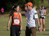 Nov 14, 2015; Claremont, CA, USA; Occidental College Tigers coach Robert Bartlett (right) with Eva Townsend (187) before the start of the womens race during the 2015 NCAA Division III West Regionals cross country championships at Pomona-Pitzer College. (Freelance photo by Kirby Lee)
