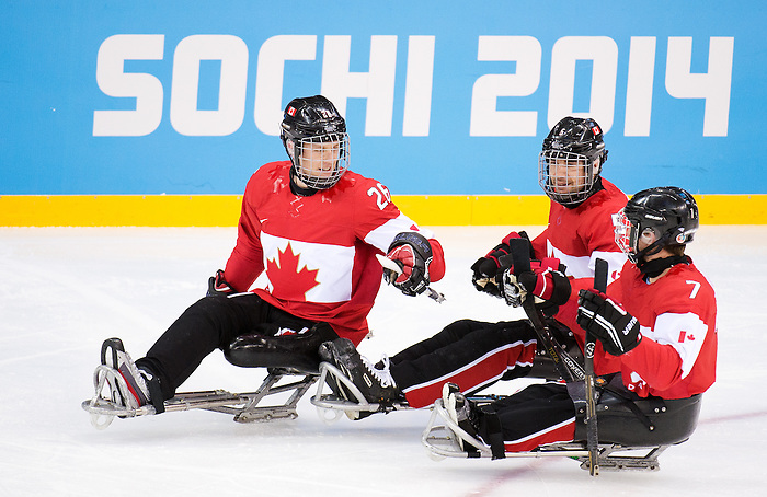 Sochi, RUSSIA - Mar 8 2014 -  Dominic Larocque is congratulated on his goal by Kevin Rempel and Marc Dorion Canada takes on Sweden during the 2014 Paralympic Winter Games in Sochi, Russia.  (Photo: Matthew Murnaghan/Canadian Paralympic Committee)