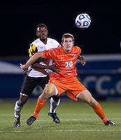 Suli Dainkeh (22) of Maryland stays close to Austen Burnikel (20) of Clemson during the ACC tournament semifinals at the Maryland SoccerPlex in Boyds, MD.  Maryland defeated Clemson, 1-0, in overtime.