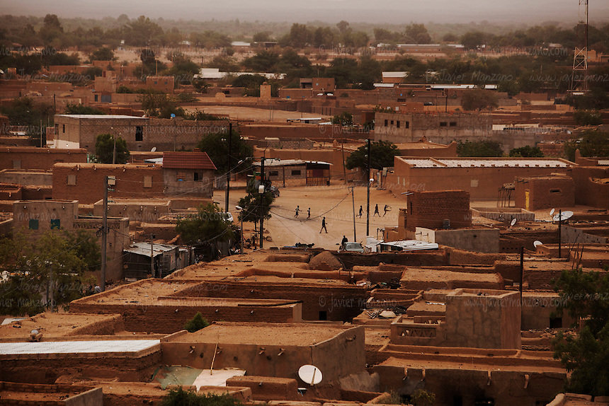 AGADEZ, NIGER &mdash; <br /> Agadez, is the largest city in central Niger with an estimated population of over 120,000 people. This city, comprised mainly of one-story mud structures, is situated on the southern outskirts of the Sahara desert and has been an important trade center for centuries. Tuareg and Berber tribes have traveled the many commercial routes that run through the desert for more than a thousand years. Today, this city has become one of the largest human smuggling and drug trafficking routes in West Africa. Thousands of migrants attempting to reach Europe are smuggled through the Sahara desert to Libya, Algeria and Morocco in their attempts to reach Italy and Spain.