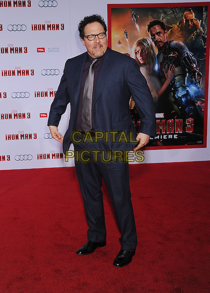 "Jon Favreau.The Los Angeles Premiere of ""Iron Man 3"" at El Capitan Theatre in Hollywood, California, USA..April 24th, 2013.full length blue suit purple shirt tie glasses goatee facial hair   .CAP/ROT/TM.©Tony Michaels/Roth Stock/Capital Pictures"