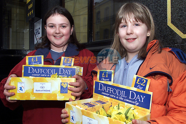 Kimberly Irwin and Jennifer Glennon pictured selling some daffodils for cancer care in the community..pic:Arthur Carron/ Newsfile
