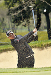 JEJU, SOUTH KOREA - APRIL 24:  Lam Chih-bing of Singapore plays a bunker shot on the 12th hole during the Round Two of the Ballantine's Championship at Pinx Golf Club on April 24, 2010 in Jeju island, South Korea. Photo by Victor Fraile / The Power of Sport Images