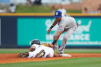 Biloxi Shuckers shortstop Orlando Arcia (2) tags out Juan Perez (2) on a pickoff during the second game of a double header against the Pensacola Blue Wahoos on April 26, 2015 at Pensacola Bayfront Stadium in Pensacola, Florida.  Pensacola defeated Biloxi 2-1.  (Mike Janes/Four Seam Images)