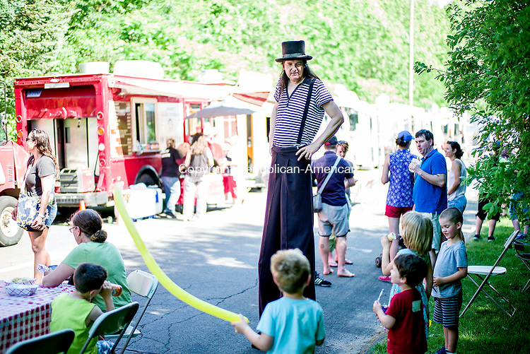 Oxford, CT- 11 June 2017-061117CM06-  The Amazing Andy of Hamden jokes around with children during the third annual Food & Arts Fest on Great Oak Road in Oxford on Sunday.  The event featured, food, various booths, crafts and live music.    Christopher Massa Republican-American