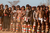 Xingu Indigenous Park, Mato Grosso, Brazil. Aldeia Matipu. Huka Huka wrestling at the Kuarup ceremony. Young warriors watching the fight.