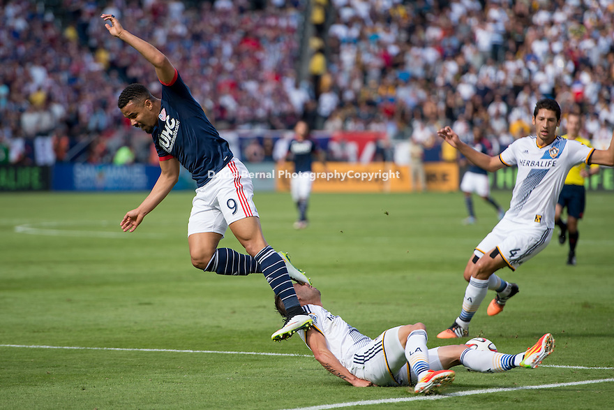 CARSON, CA - December 7, 2014: LA Galaxy midfielder Marcelo Sarvas (8) accidentally gets kicked in the face. The MLS Cup. LA Galaxy vs New England Revolution match at the StubHub Center in Carson, California. Final score, LA Galaxy 2, New England Revolution 1 (2 OT).