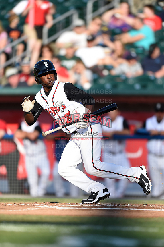 Lansing Lugnuts outfielder D.J. Davis (8) fouls off a bunt attempt during a game against the South Bend Silver Hawks on June 6, 2014 at Cooley Law School Stadium in Lansing, Michigan.  South Bend defeated Lansing 13-5.  (Mike Janes/Four Seam Images)