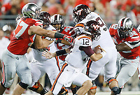Ohio State Buckeyes defensive lineman Joey Bosa (97), Ohio State Buckeyes linebacker Darron Lee (43) and Ohio State Buckeyes defensive lineman Adolphus Washington (92) chase after Virginia Tech Hokies quarterback Michael Brewer (12) during the college football game between the Ohio State Buckeyes and the Virginia Tech Hokies at Ohio Stadium in Columbus, Saturday afternoon, September 6, 2014. The Virginia Tech Hokies defeated the Ohio State Buckeyes 35 - 21. (The Columbus Dispatch / Eamon Queeney)