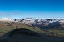 16/04/16 <br /> <br /> After a dusting of overnight snow a walker scales Mam Tor near Castleton to witness the spectacular snow-topped Derbyshire Peak District landscape.<br /> <br /> All Rights Reserved: F Stop Press Ltd. +44(0)1335 418365   +44 (0)7765 242650 www.fstoppress.com