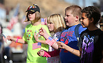 From left, Mackenzie Tackett, 10, Emma Burns, 6, Taylor Burns, 7, and Anthony Marco, 7, watch the annual Veterans Day parade in Virginia City, Nev., on Monday, Nov. 11, 2013.<br /> Photo by Cathleen Allison
