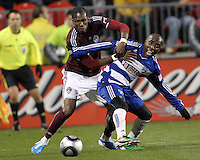 Jair Benitez#5 of FC Dallas holds Macouma Kandji#10 of the Colorado Rapids during MLS Cup 2010 at BMO Stadium in Toronto, Ontario on November 21 2010. Colorado won 2-1 in overtime.