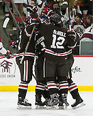 The Bears celebrate Nick Lappin's first goal of the game. - The Harvard University Crimson defeated the Brown University Bears 4-3 to sweep their first round match up in the ECAC playoffs on Saturday, March 7, 2015, at Bright-Landry Hockey Center in Cambridge, Massachusetts.