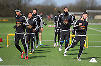 Kyle Naughton (L) and Jordi Amat (R) during the Swansea City FC training at Fairwood training ground in Wales, UK on Wednesday 06 April 2016