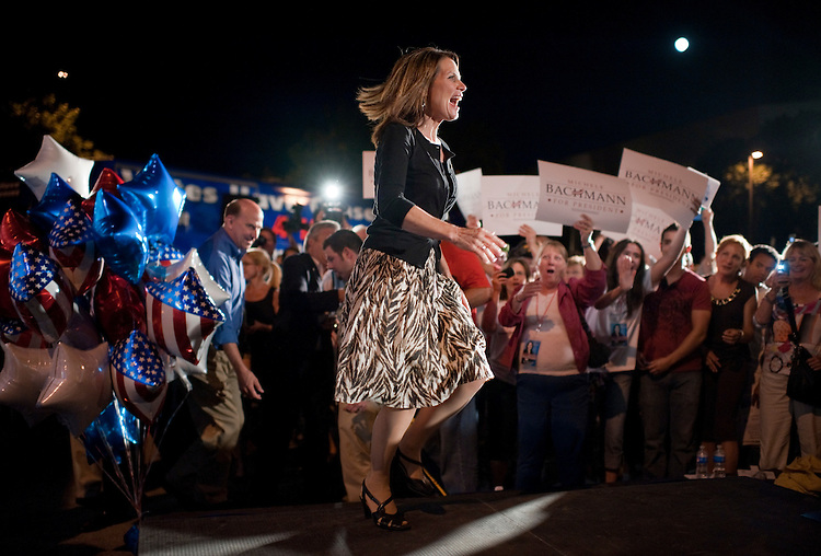 UNITED STATES - AUGUST 12:  Rep. Michele Bachmann, R-Minn., arrives on stage to rally supporters on the campus of Iowa State University in Ames, Iowa, the night before the Ames straw poll.  Rep. Louie Gohmert, R-Texas, appears at left.  (Photo By Tom Williams/Roll Call)