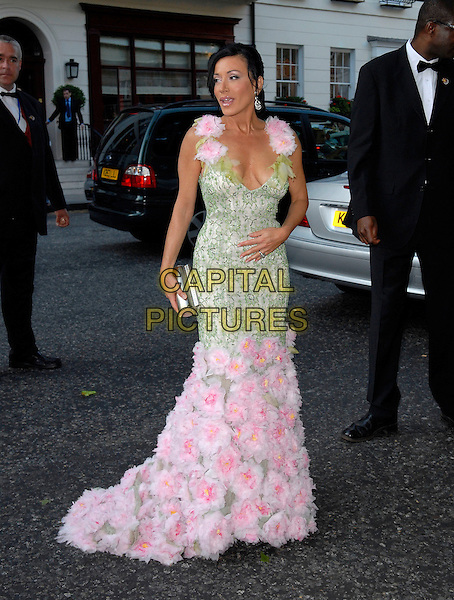 NANCY DELL'OLIO.Arrivals at the 4th Annual Glamour Women Of The Year Awards, Berkely Square Gardens, London, England. .June 5th 2007.full length green pink dress flowers long train silver clutch purse low cut cleavage .CAP/FIN.©Steve Finn/Capital Pictures