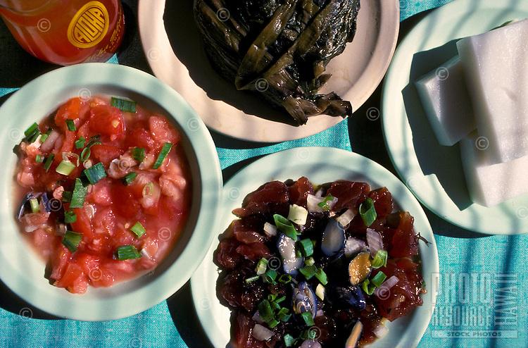 Hawaiian food plates (clockwise from left) lomi salmon, laulau, haupia, poke, from Helena's Restaurant, Honolulu, Oahu