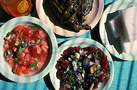 Hawaiian food plates (clockwise from left) lomi salmon, laulau, haupia, poke, from Helena's Restaurant, Honolulu, Oahu
