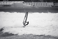A large southerly storm whipped up  huge seas & strong winds around Wellington in New Zealand. A few windsurfers braved the conditions & headed out at Lyall Bay late in the afternoon on the 9th August 2010.