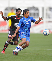 El Salvador National Team midfielder Josue Flores (20) shield the ball against DC United midfielder Clyde Simms.  DC United defeated El Salvador National Team 1-0 in a international charity match at RFK Stadium, Saturday June 19, 2010.