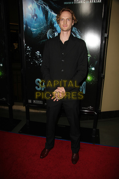 """CHRISTOPHER BAKER.""""Sanctum"""" World Premiere held at The Mann's Chinese 6, Los Angeles, California, USA..January 31st, 2011.full length black suit.CAP/ADM/TB.©Tommaso Boddi/AdMedia/Capital Pictures."""