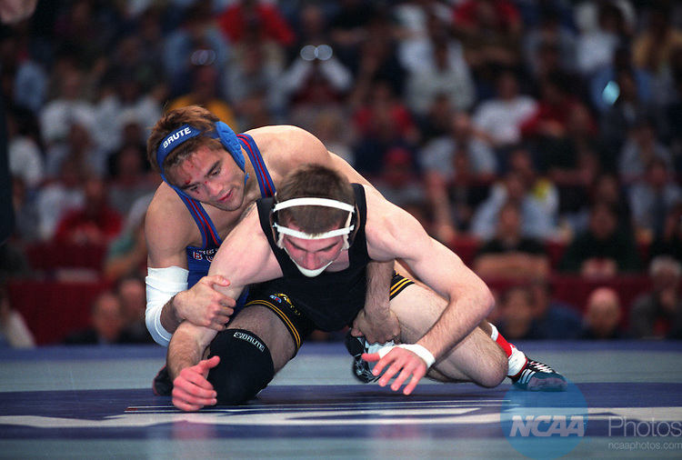 23 MAR 2002: Stephen Abas (in blue) of Fresno State grabs Luke Eustice (in black) of the University of Iowa during the 125 pound match of the NCAA Division 1 Wrestling Championships held at the Pepsi Arena in Albany, NY.  Abas won the match to win the championship title. Joe Connell/NCAA Photos